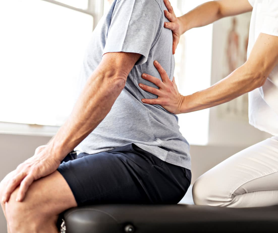 physiotherapy worker with senior client