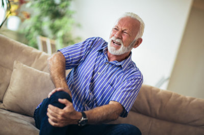 senior man suffering from knee pain