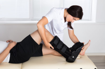 female therapist holding the ankle